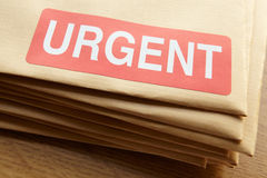 Urgent documents for despatch. On wooden desk royalty free stock image