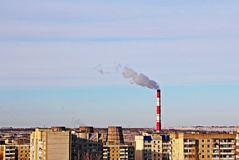 Urgent environmental problem of small city. The thermal power plant pollutes the air in the residential area of the city Royalty Free Stock Photos