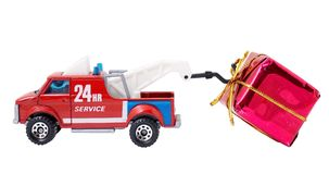 Urgent express gift. 24HR service truck expressing a big gift Stock Image