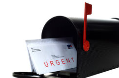 Urgent Letter. In Mail box with red flag standing up, stamp is made from one of photographers stock images of an american flag Royalty Free Stock Photography