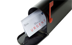 Urgent Letter. In Mail box with red flag standing up, stamp is made from one of photographers stock images of an american flag stock photo