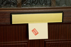Urgent letter in mailbox Royalty Free Stock Photo