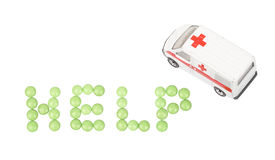 Urgent medical treatment. Pills formed help with ambulance car, isolated on white background Stock Image