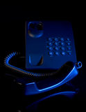 Urgent night phone talk Royalty Free Stock Photo