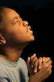 Urgent Prayer. A boy fervently prays to God Royalty Free Stock Photography