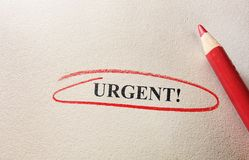 Urgent in red circle Stock Photos