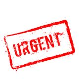 Urgent red rubber stamp isolated on white. Royalty Free Stock Photography