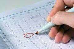 Urgent Reminder. Marking a planner with an urgent reminder stock photos