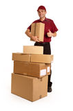 Urgent shipping. Isolated image of a messenger in red delivering a lot of boxes Stock Image