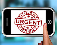 Urgent On Smartphone Showing Immediate Need Stock Photo