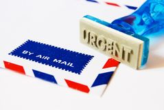 Urgent stamp on air mail Royalty Free Stock Photography