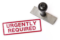 Urgently required text label stamp for documents. Urgently required red text sign label stamp with stamper isolated white paper background documents stock image