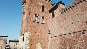 Urgnano, Bergamo, Italy. The medieval castle in the center of the village. Spring time stock footage