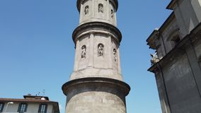 Urgnano, Bergamo, Italy. View of the bell tower of the main church in the center of the village stock video