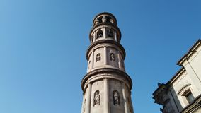 Urgnano, Bergamo, Italy. View of the bell tower of the main church in the center of the village stock video footage