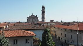 Urgnano, Bergamo, Italy. View of the village, the church and the bell tower from the medieval castle stock video