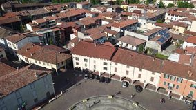 Urgnano, Bergamo, Italy. View of the village and the main square from the top of the bell tower stock video footage