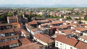 Urgnano, Bergamo, Italy. View of the village and the medieval castle from the top of the bell tower stock video footage