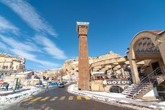 URGUP, TURKEY - JAN 22, 2019: Clock tower at ancient town center of snowy Urgup, Nevsehir city. The city has been added to unesco stock photography