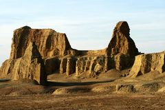 Urho ghost castle. Located at the northwest edge of Zhungarian Basin in Xinjiang and 100 kilometers northeast of Karamay City, Urho Ghost Castle is also known as Stock Images