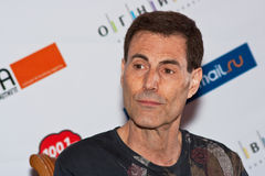 Uri Geller listens to a question of the journalist Royalty Free Stock Images