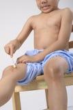 Uricaria occur in kid leg Stock Photos