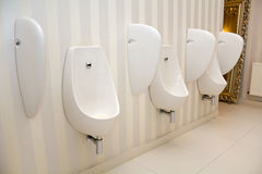 Urinal. Modern restroom interior with urinal row stock images