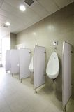 Urinal. S in modern office building Stock Photos