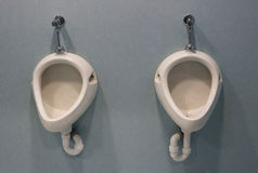 The urinal, blue fundal/background Royalty Free Stock Image