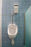 Urinal with a deodorant system on a public toilet Royalty Free Stock Images