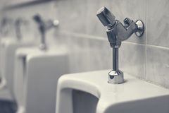 Urinal in the male toilet inside the oil service. Urinal in the male toilet dark inside the oil service Stock Photo