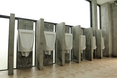 Urinal man clean toilets Royalty Free Stock Photo
