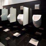 Urinal man clean toilets Stock Photo