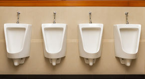 Urinal man four clean toilets in public toilets. Stock Image