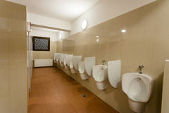 Urinal. Modern restroom interior with urinal row.Horizontal shot stock photos