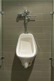 Urinal montado na parede Fotografia de Stock
