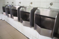 Urinal at public filling station. Royalty Free Stock Images