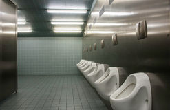 Urinal in a public restroom Stock Photography