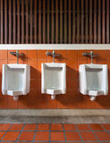 Urinal in public toilet Stock Photo