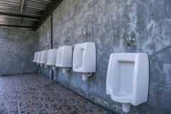 Urinal row. In a public restroom Royalty Free Stock Images