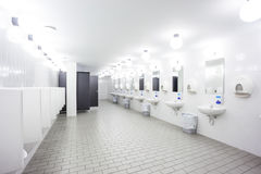 Urinal and sink Stock Photo