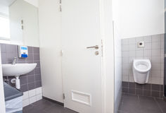 Urinal and sink Royalty Free Stock Photos