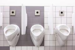 Urinal sur le mur Images stock