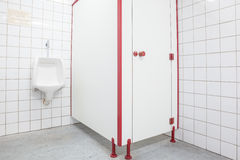 Urinal and toilet door Stock Images