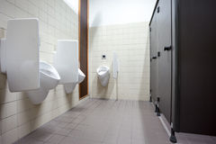Urinal and toilet doors Stock Photos