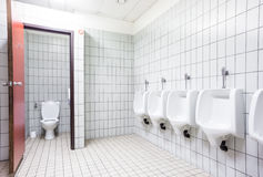 Urinal and toilet doors Royalty Free Stock Image