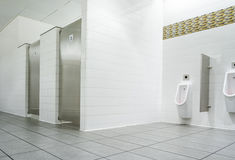 Urinal and toilet doors Stock Photography