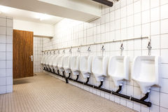 Urinal and toilet doors Royalty Free Stock Photography