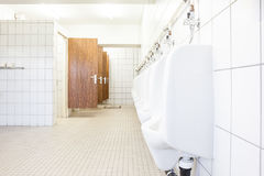 Urinal and toilet doors Stock Photo