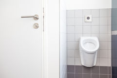 Urinal and toilet doors Stock Images